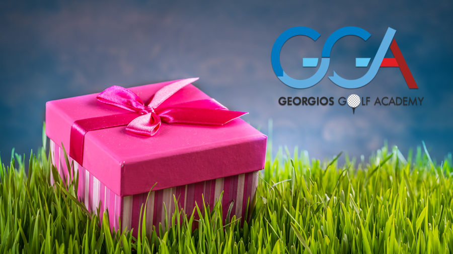 Gift box on the green grass